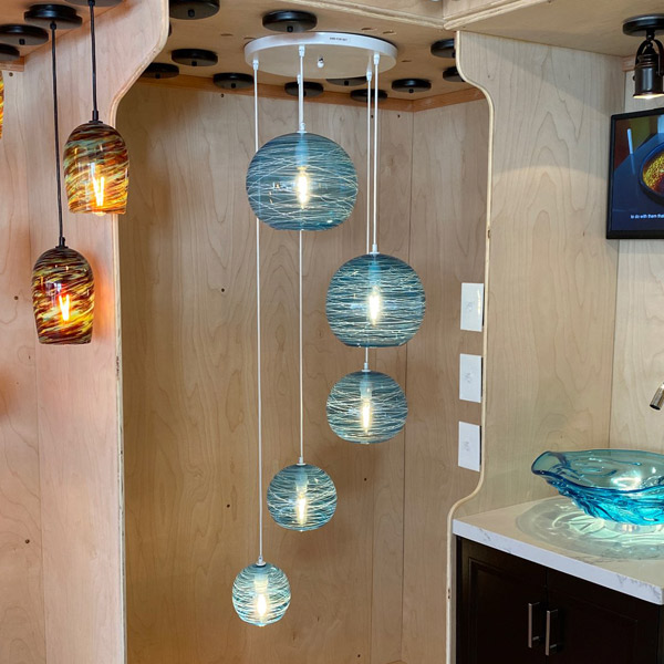 <p>Five Piece Cascade Chandelier in Aqua Blue with White Threading<br>Length varies, standard is appx. 4'6″ high<br> Custom height available on request<br>Retail Price: $8600</p>